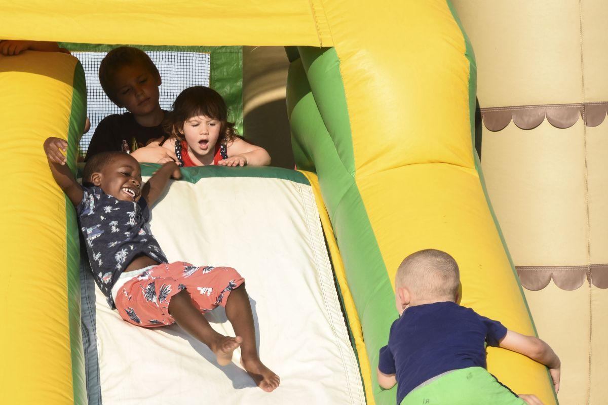 Children enjoy the inflatable slide at Freedom Fest July 3, 2018, on Grand Forks Air Force Base, North Dakota.
