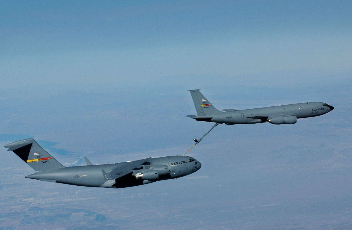 A KC-135R from the 336th Air Refueling Squadron refuels a C-17A from the 729th Airlift Squadron. Both aircraft are from the Air Force Reserve Command's 452nd Air Mobility Wing. March Air Reserve Base