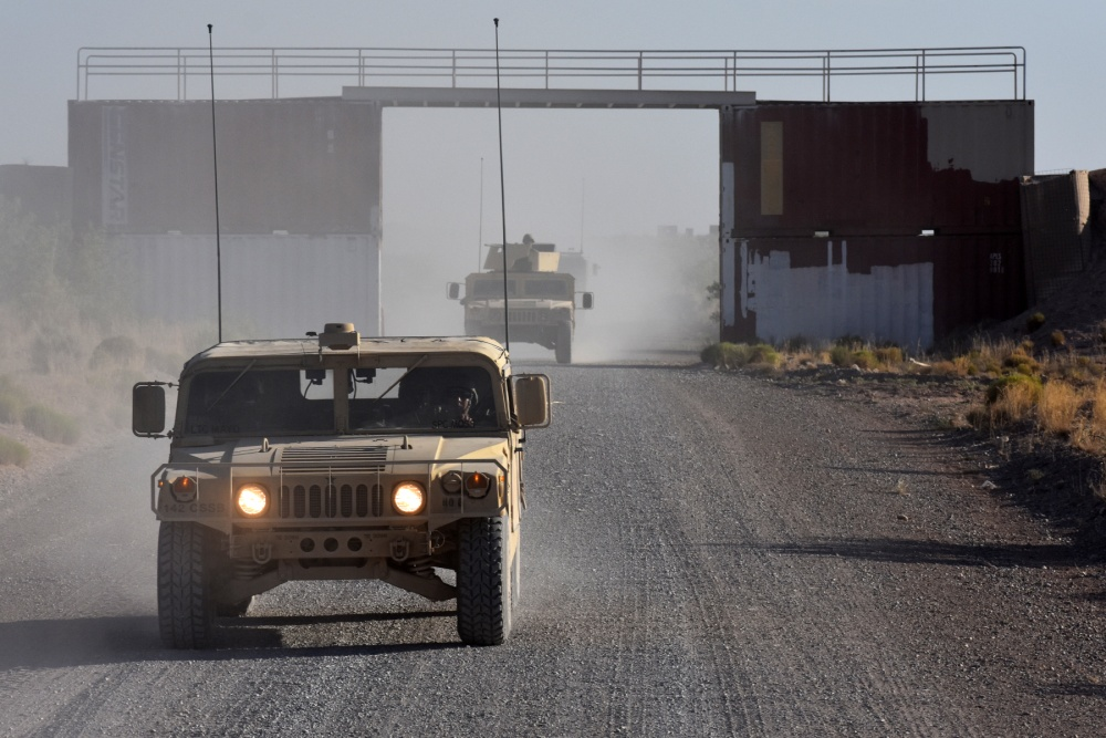 Convoy vehicles assigned to the 504th Composite Supply Company, 142nd Combat Sustainment Support Battalion, 1st Armored Division, travel down a route during a convoy protection live-fire exercise. Fort Bliss, Texas