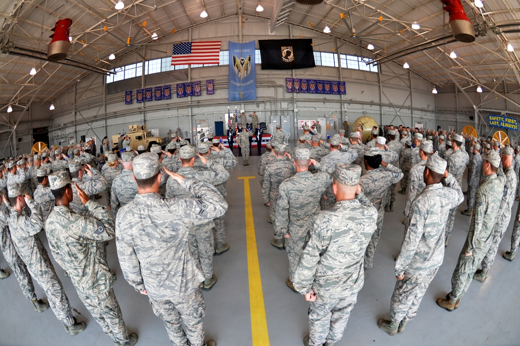 Airmen from the 1st Special Operations Mission Support Group salute during the 1st SOMSG change of command ceremony at the Commando Hangar on Hurlburt Field, Fla.