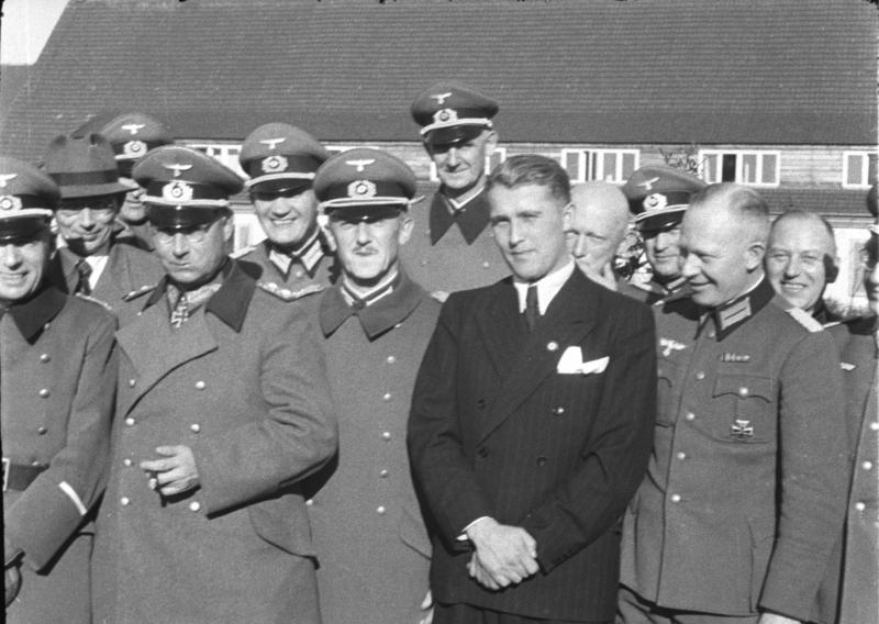 Wernher von Braun (in civilian clothes) with fellow German officers in 1941.