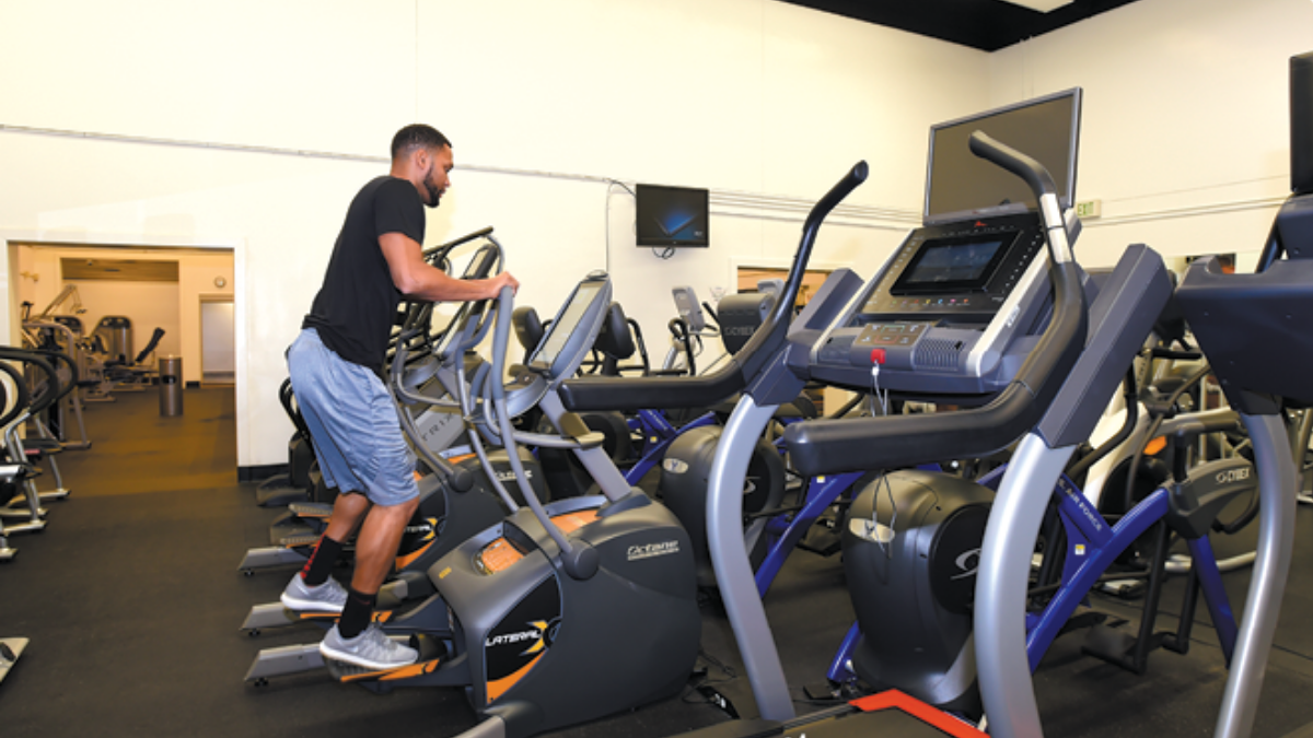Rosburg Fitness and Sports Center man working out, Edwards Air Force Base Parks and Recreation