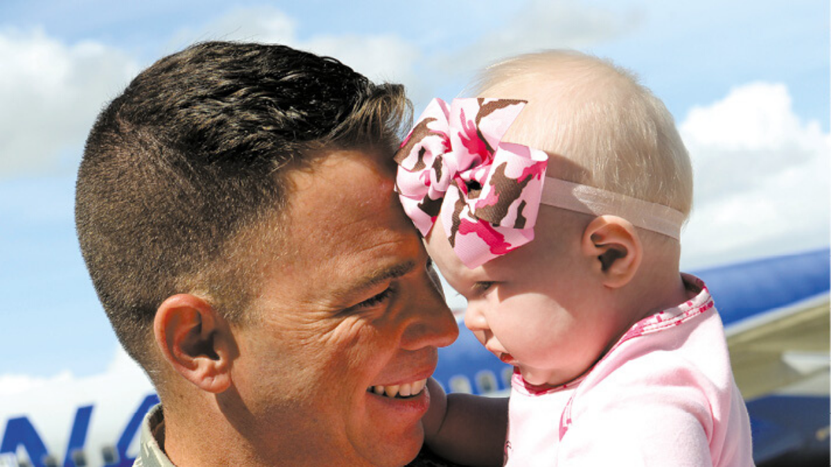 Soldier with baby, Hill Air Force Base
