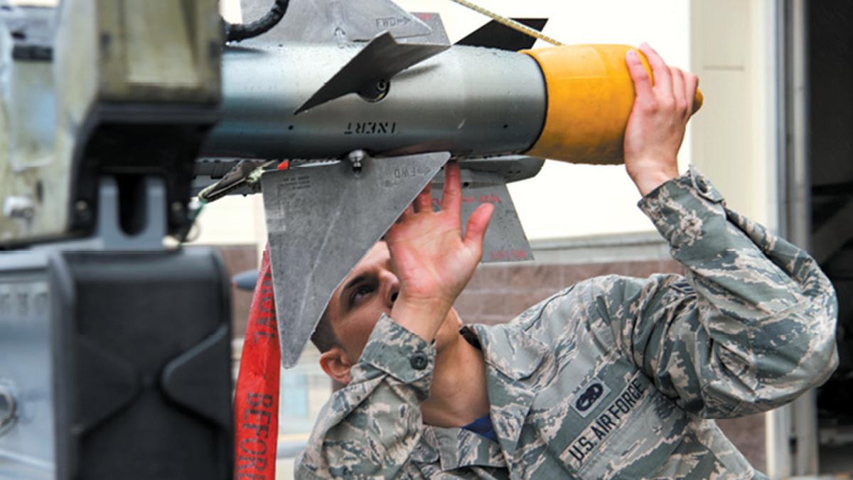Airman inspecting missile, Joint Base Elmendorf-RIchardson, JBER