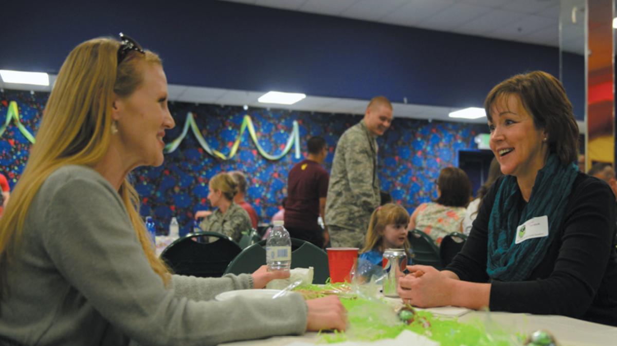 Women talking at party, Joint Base Elmendorf-Richardson, JBER