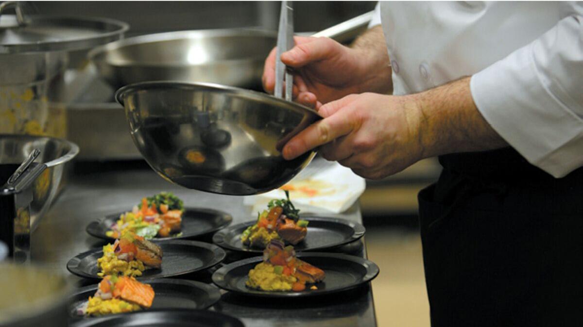 Chef making food in kitchen, Joint Base Elmendorf-Richardson, JBER