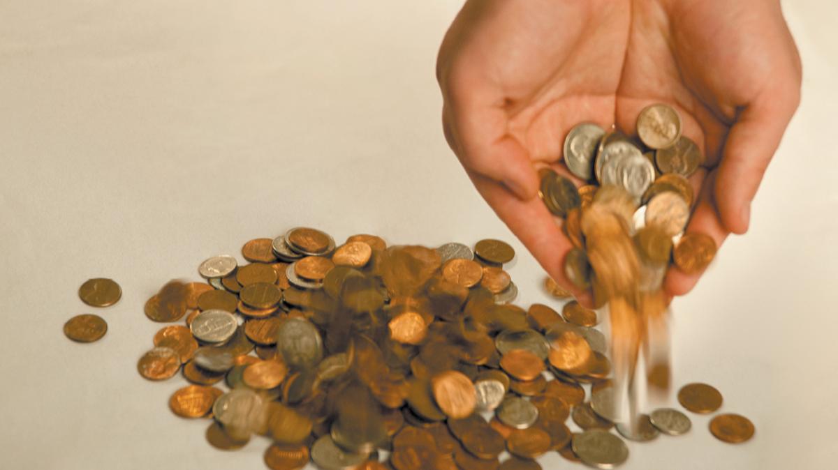 Coins falling out of hands - Money Matters, Joint Base Elmendorf-Richardson, JBER