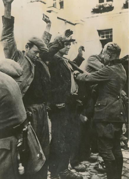 German troops rounding up Poles in Warsaw, 1941.