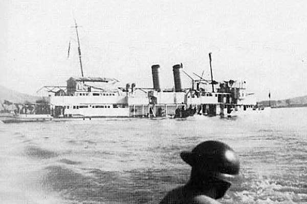 The USS Panay sinking in the Yangtze River.