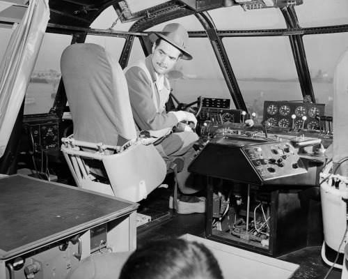 Hughes in the cockpit of the Hercules.