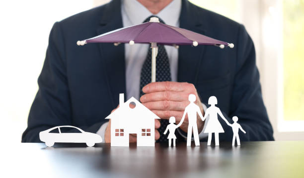 General agent protecting a family, a house and a car with his hands